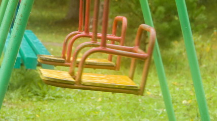 Two swing shakes on empty playground, closeup