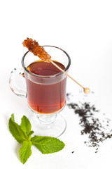 Tea with Mint Leaf and Candy Brown Sugar on a Sticks