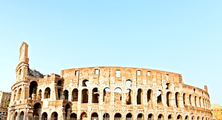 ROME - CIRCA 2014: Coliseum monument as tourists pass by.