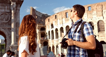 Pretty Tourist Couple on Vacation in Rome Map Camera Photos