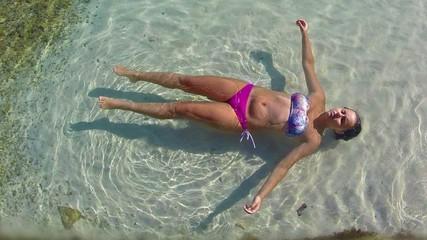woman swimming in tropical coral lagoon