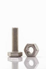Closeup metal screw and nuts.