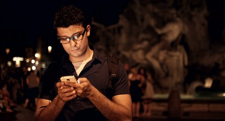Handsome Young Man Using Smart Phone texting SMS 4g Network