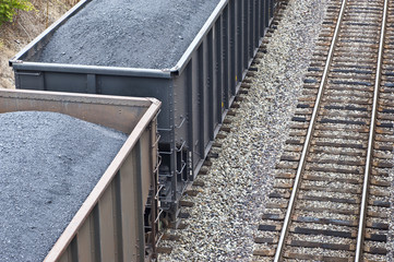 Train Cars Loaded With Coal Next To More Tracks