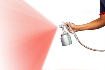hand holding spray gun