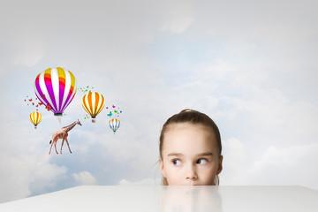 Giraffe flying on balloons