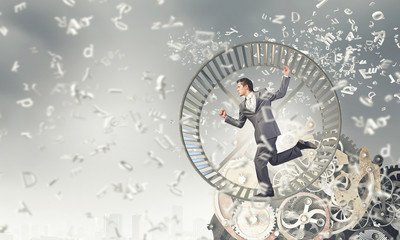 Businessman in wheel
