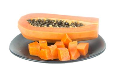 Slice papaya fruit on dish isolated on white