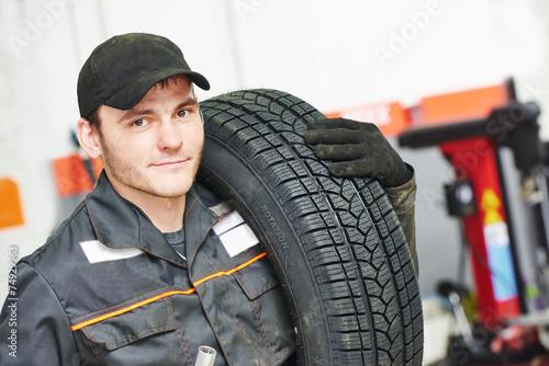 tire repairman auto mechanic - 74929963
