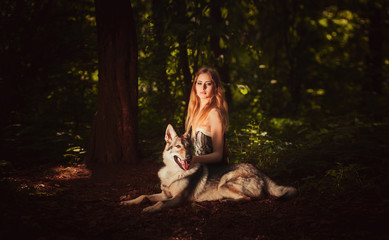 Cute young lady with dog