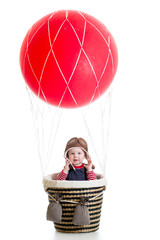 child boy on hot air balloon isolated on white