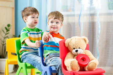 Two little boys playing role game in daycare