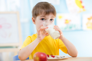 child drinking healthy beverage at home