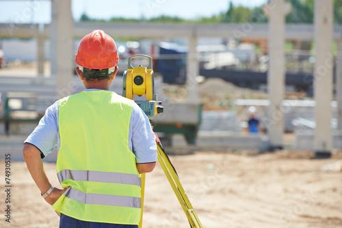 Leinwanddruck Bild surveyor worker with theodolite
