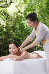 Young woman bathing