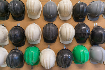 Protection helmets on wall