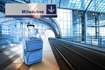 Departure for Milwaukee. Blue suitcase at the railway station