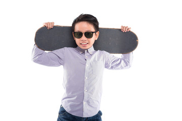 Young skateboarder in sunglasses