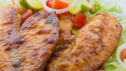 Breaded tilapia fillet or steak with garden salad