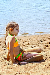 Girl on sand by the river