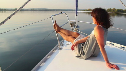 Young beautiful girl enjoying vacation on luxury yacht, tourism
