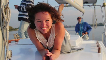 Pretty lady smiling at camera, enjoying rest on sailing yacht