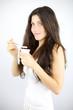 Happy girl having healthy breakfast with eating yogurt