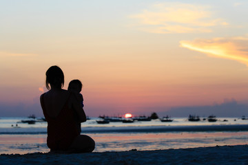 mother and little daughter on sunset