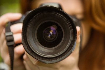 Close up of female photographer