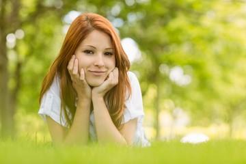 Portrait of a pretty redhead content