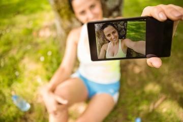Smiling fit brunette taking a selfie