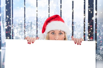 Composite image of festive blonde showing white poster