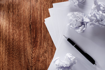 Blank Documents and Crumpled Papers on Table