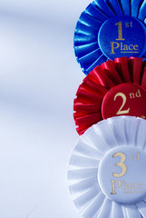 Set of three winners rosettes and ribbons