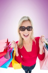 Happy blonde holding shopping bags