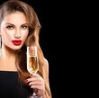 Sexy model girl with glass of champagne over black