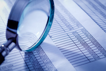 Conceptual Magnifying Glass on Invoice Reports