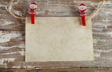 Empty paper  on  a  wooden christmas background