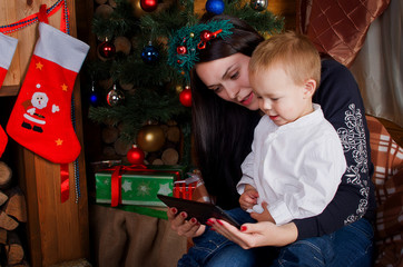 Mom and son holding a tablet PC