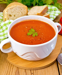 Soup tomato with pepper in bowl on board