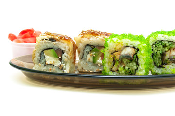 Japanese cuisine: rolls with smoked eel, cucumber, salmon and av