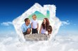 Composite image of radiant family at the beach