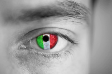 Men portrait with eyes the color of  Ireland flag