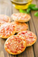 mini pizza on wooden table