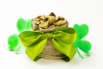 green clover leaves and a bag of gold - St. Patrick's Day