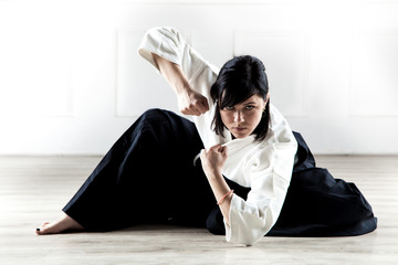 beautiful woman wearing a hakama practicing Aikido