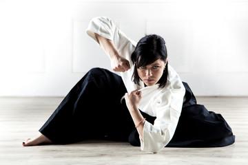 beautiful woman wearing a hakama practicing Aikido