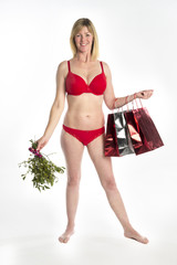 Woman in red underwear with Christmas shopping