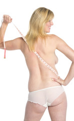Topless woman holding tape measure