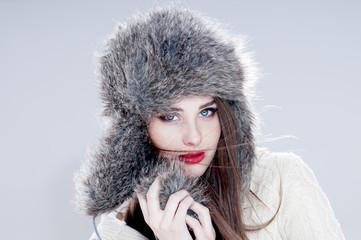 Winter fashion woman in a fur  hat.